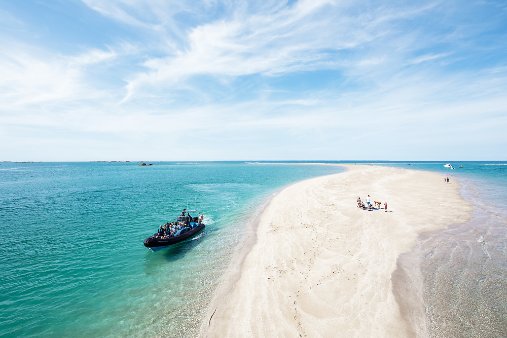 Seafaris boat excursions taking people to the beautiful sandbanks and turquoise waters of the Minquiers