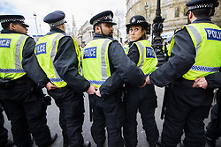 © Licensed to London News Pictures . 01/04/2017 . London , UK . Hundreds of police separate rival demonstrations on Whitehall . The EDL and Britain First both hold demonstrations in London , opposed by anti-fascist groups , including Unite Against Fascism . Photo credit : Joel Goodman/LNP