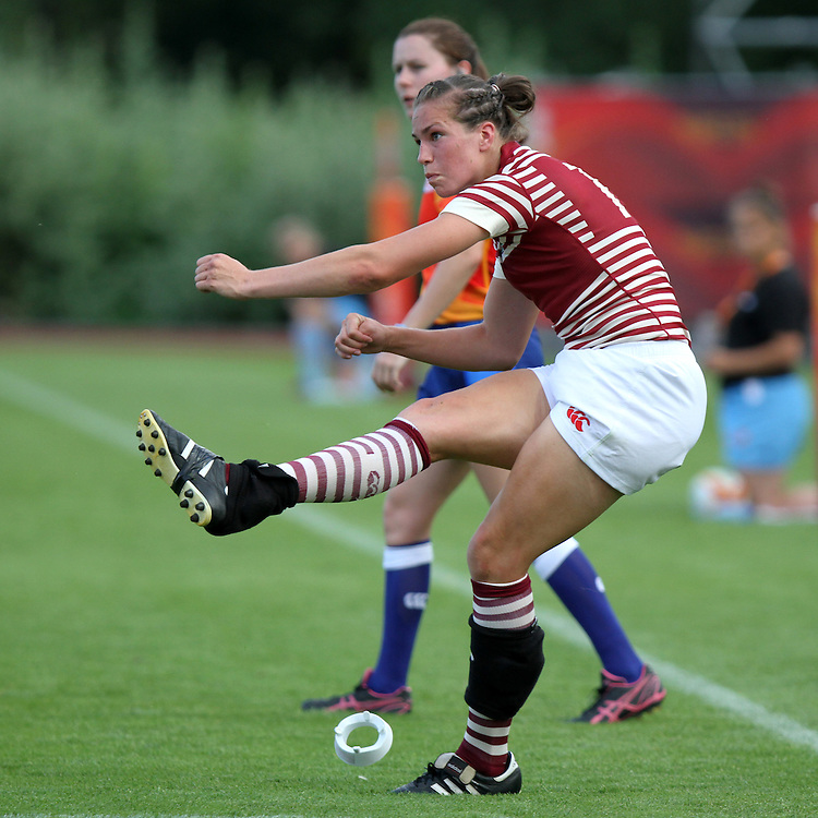Emily Scarratt takes a conversion kick. England v Samoa Pool A group game, WRWC 2014 at Centre National de Rugby, Marcoussis, France, on 1st August 2014
