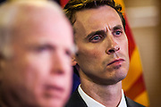 15 AUGUST 2012 - PHOENIX, AZ: Sen. JOHN MCCAIN (left) next to Congressman BEN QUAYLE at a press conference Wednesday. Arizona's Republican US Senators, John McCain and Jon Kyl, announced their endorsement of Congressman Ben Quayle (R-AZ) during a press conference in Phoenix Wednesday. They decried the campaign being run by Quayle's opponent, Congressman David Schweikert (R-AZ). Both Quayle and Schweikert are freshman Congressmen from neighboring districts. They were thrown into the same district during the redistricting process and are now waging a bitter primary fight against each other.   PHOTO BY JACK KURTZ
