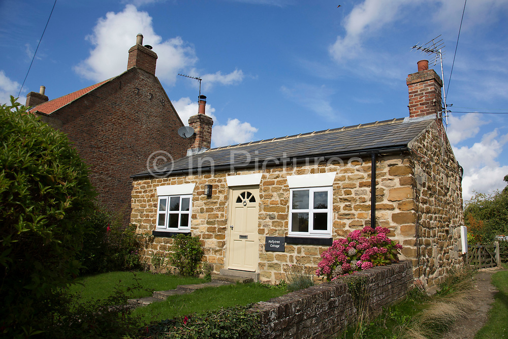 Hollytree Cottage, a traditional village cottage in Husthwaite, Yorkshire, England, UK.