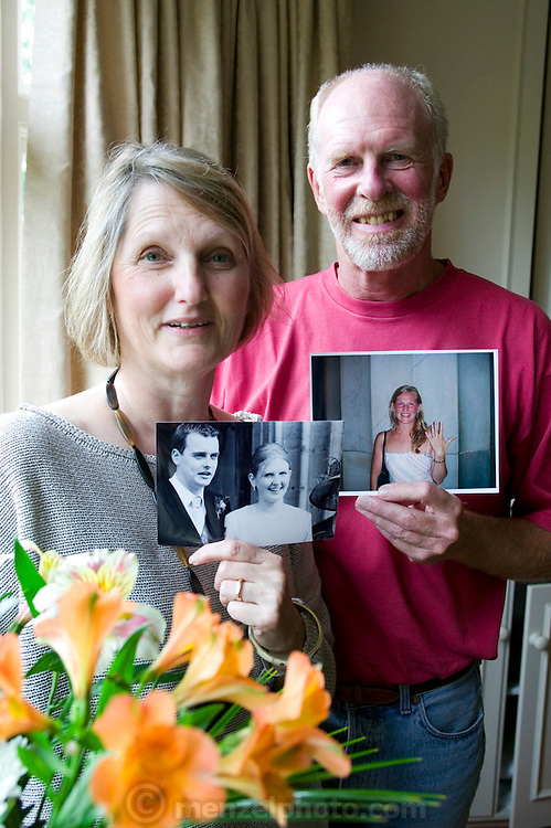 Richard and Fenella Hodson, Godalming, UK. (Material World Family from Great Britain UK) with photos of their daughters Alice and Eleanore and their new son-in-law.