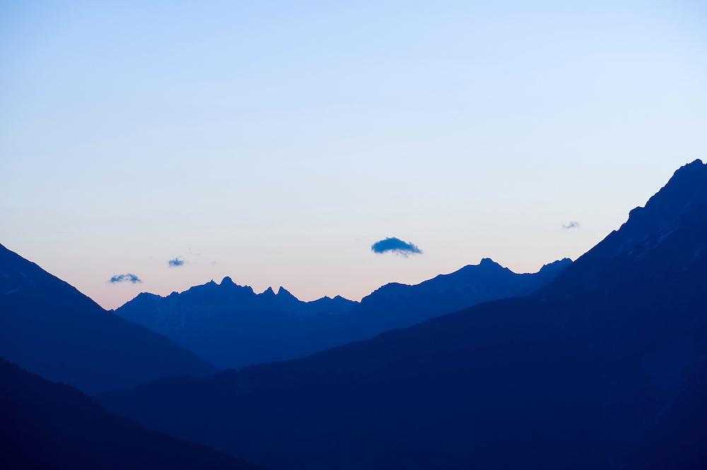 IFTE-NB-007869; Niall Benvie; View from Kaunerberg; Tirol; Austria; Europe; ötztaler Alps; mountains forest; horizontal; high pointed steep treeline; green white blue; upland mountain hill slope woodland forest; 2008; July; summer; evening dusk; Wild Wonders of Europe Naturpark Kaunergrat