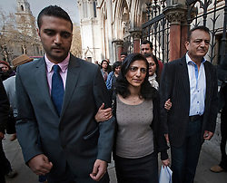 © Licensed to London News Pictures. 30/03/2012. London, UK.  Family of Anni Dewani L to R Anish Hindocha (Brother) Ami Denborg (Sister) Vinod Hindocha (Father) leaving The High Court on March 30, 2012 where a judge temporarily halted British businessman Shrien Dewani's extradition to South Africa on mental health grounds. Shrien Dewani, is accused of arranging the contract killing of wife Anni in Cape Town in November 2010. Photo credit : Ben Cawthra/LNP