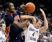 BYU guard Jackson Emery (4) is fouled by Fresno Pacific center Jerante Morgan, left, during the second half of an NCAA college basketball game, Saturday, Jan. 1, 2011, in Provo, Utah. BYU defeated Fresno Pacific 93-57. (AP Photo/Colin E Braley)