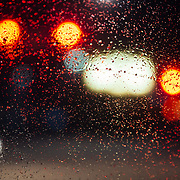Traffic lights through the windshield of a Toyota FJ Cruiser during the first large winter storm of the Season in Jackson, Wyoming.