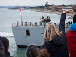 © Licensed to London News Pictures. 28/10/2016. Portsmouth, UK.  Relatives welcome the Royal Navy Type 45 Destroyer HMS Diamond back to Portsmouth after completing her two month operation countering the illegal arms trade into Libya. The Portsmouth-based Destroyer has now handed over duties in the Central Mediterranean Sea to another Royal Navy ship, RFA Mounts Bay.  Photo credit: Rob Arnold/LNP