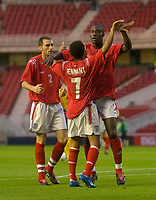 Fotball<br /> U21 England v Ukraina<br /> 17.08.2004<br /> Foto: SBI/Digitalsport<br /> NORWAY ONLY<br /> <br /> England's Carlton Cole (R) celebrates scoring his side's first goal with Jermaine Pennant (C).