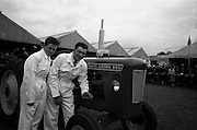 06/05/1965<br /> 05/06/1965<br /> 06 May 1965<br /> Final of the 4th Annual David Brown Tractor and Implement Maintenance Competition held at the RDS Spring Show, Ballsbridge, Dublin. Thomas Lambe (right), Ballinagarry, Ballymackney, Dundalk with his helper Peadar Markey the team representing Monaghan.