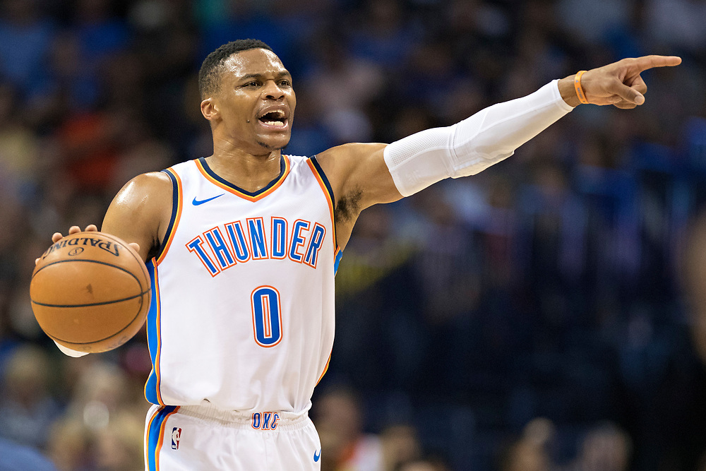 OKLAHOMA CITY, OK - OCTOBER 25:  Russell Westbrook #0 of the Oklahoma City Thunder points to his team during a game against the Indiana Pacers at the Chesapeake Energy Arena on October 25, 2017 in Oklahoma City, Oklahoma.  NOTE TO USER: User expressly acknowledges and agrees that, by downloading and or using this photograph, User is consenting to the terms and conditions of the Getty Images License Agreement.  (Photo by Wesley Hitt/Getty Images) *** Local Caption *** Russell Westbrook