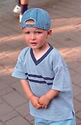 Boy age 4 in city center looking upset.  Zakopane Poland