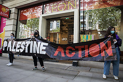 Activists from Palestine Action stand behind a banner during a protest outside the UK headquarters of Elbit Systems, an Israel-based company developing technologies used for military applications including drones, precision guidance, surveillance and intruder-detection systems, on 11th May 2021 in London, United Kingdom. The activists were protesting against the company's presence in the UK and in solidarity with the Palestinian people following attempts at forced evictions of Palestinian families in the Sheikh Jarrah neighbourhood of East Jerusalem, the deployment of Israeli forces against worshippers at the Al-Aqsa mosque during Ramadan and air strikes on Gaza which have killed several children.
