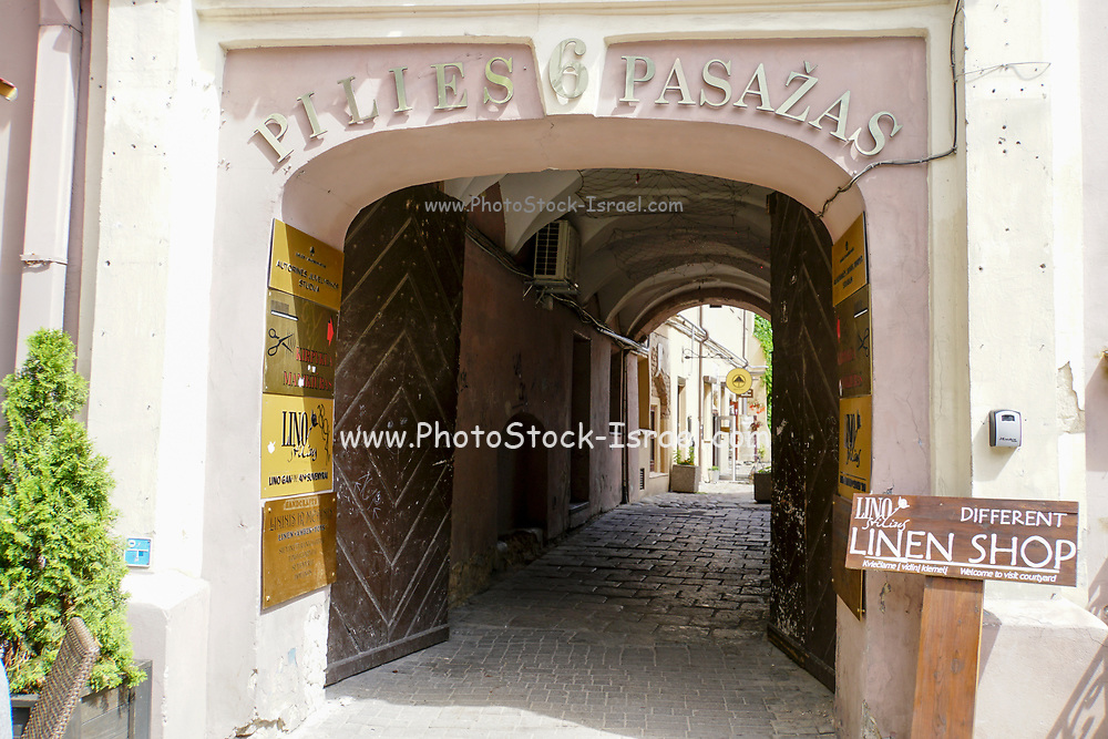 arched passage of a building in Pilies street, in old town Vilnius Lithuania