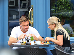 Stoke City goalkeeper Jack Butland and his fiancee Annabel Peyton sit outside Juniper Cafe Bar in Hale Village, Cheshire on Monday afternoon.