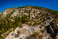 Seismites are formed when seismic waves transform sediments into a kind of quicksand. When the overlying sediment is denser, it becomes folded and these deformed structures called seismites are created.Geoparque del Cuaternario,  Granada Province, Andalusia, Spain.