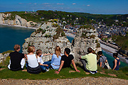 Tourists enjoying the sunshine in Etretat, Normandy, France
