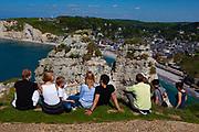 Tourists enjoying the sunshine in Etretat, Normandy, France