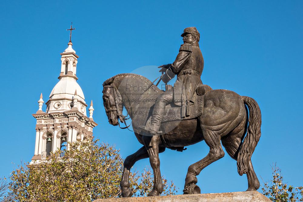 Monument to General Ignacio Zaragoza with the bell tower of the Iglesia Sagrado Corazon de Jesus church in the Macroplaza Grand Plaza adjacent to the Barrio Antiguo neighborhood of Monterrey, Nuevo Leon, Mexico.