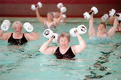 Participants in  a water aerobics class use Styrofoam barbells to work out at the Plunge in Hayward, Calif., Monday, Aug. 7, 2000. (Photo by D. Ross Cameron)