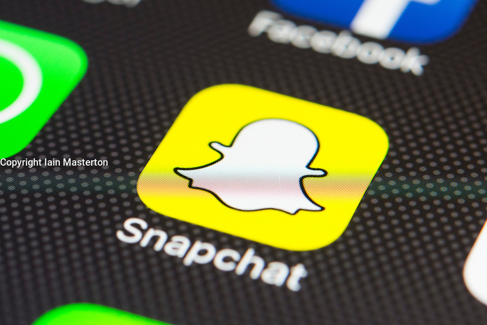 Snapchat social media app close up on iPhone smart phone screen
