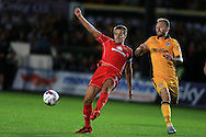 Scott Wooton of Milton Keynes Dons in action (l). EFL cup, 1st round match, Newport county v Milton Keynes Dons at Rodney Parade in Newport, South Wales on Tuesday 9th August 2016.<br /> pic by Andrew Orchard, Andrew Orchard sports photography.