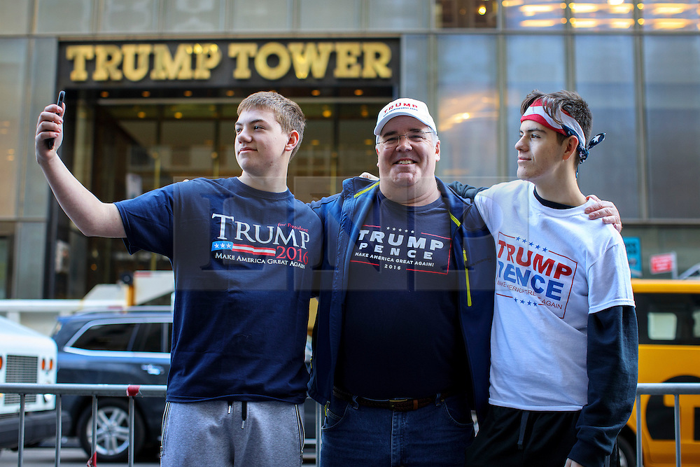 © Licensed to London News Pictures. 08/11/2016. New York CIty, USA. Pro-Donald Trump and Republican supporters get their pictures taken outside Trump Tower in New York City on Tuesday, 8 November, the day of the presidential election in the United States of America. Photo credit: Tolga Akmen/LNP