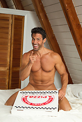naked man in bed with a pizza