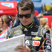 Sprint Cup Series driver Jeff Gordon (24) signs autographs for fans during the 57th Annual NASCAR Coke Zero 400 race first practice session at Daytona International Speedway on Friday, July 3, 2015 in Daytona Beach, Florida.  (AP Photo/Alex Menendez)