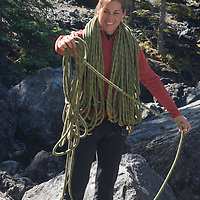 Rock climber Sasha Ruttan coils a rope at Rundle Rock near Banff, Alberta, in Canada's Banff National Park.