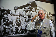 """KUNMING, CHINA - SEPTEMBER 06: (CHINA OUT)<br /> <br /> Flying Tiger Veterans Visit The Cultural Relics Exhibition Of The Flying Tigers In Kunming<br /> <br /> A Flying Tiger veteran takes photos with an image on which were his comrades at The Cultural Relics\' Exhibition of the \""""Flying Tigers\"""" at Kunming Museum on September 6, 2015 in Kunming, Yunnan Province of China. <br /> <br /> The 1st American Volunteer Group (AVG) of the Chinese Air Force in 1941–1942, nicknamed the Flying Tigers, was composed of pilots from the United States Army Air Corps (USAAC), Navy (USN), and Marine Corps (USMC), recruited under presidential authority and commanded by Claire Lee Chennault. The shark-faced nose art of the Flying Tigers remains among the most recognizable image of any individual combat aircraft or combat unit of World War II.<br /> ©Exclusivepix Media"""