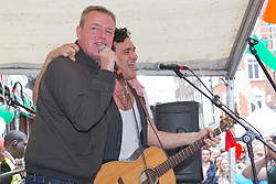 © Licensed to London News Pictures. 06/07/2014. London, England. Suggs of Madness performs at gig. Celebrities attend the 65th Anniversary Celebrations of Bar Italia in Frith Street, Soho, London, in aid of Great Ormond Street Hospital. Photo credit: Bettina Strenske/LNP