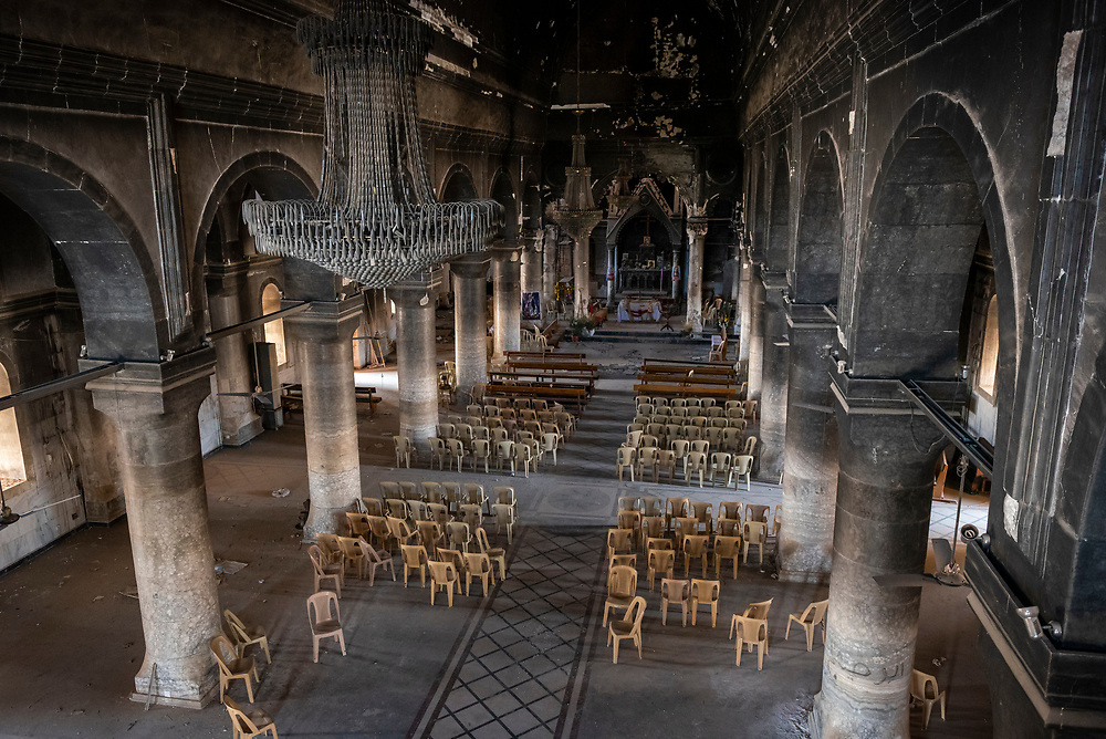 The blackened walls of the Church of the Immaculate Conception, a Syriac Catholic Church in Qaraqosh, Iraq. The church was heavily damaged by ISIS during its two-year occupation of the predominately Christian town, which ended on October 19, 2016, when Qaraqosh was liberated as part of the Battle of Mosul. (May 20, 2017)