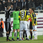 Referee's Cuneyt CAKIR (R) show the red card to Besiktas's Matteo FERRARI (L) during their Turkish Superleague Derby match Besiktas between Fenerbahce at the Inonu Stadium at Dolmabahce in Istanbul Turkey on Sunday, 20 February 2011. Photo by TURKPIX