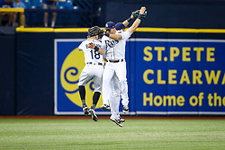August 24, 2017 - St. Petersburg, Florida, U.S. - WILL VRAGOVIC   |   Times.Tampa Bay Rays center fielder Peter Bourjos (18), right fielder Steven Souza Jr. (20), and center fielder Kevin Kiermaier (39) celebrate after the game between the Toronto Blue Jays and the Tampa Bay Rays at Tropicana Field in St. Petersburg, Fla. on Thursday, Aug. 24, 2017. The Tampa Bay Rays beat the Toronto Blue Jays 2-0. (Credit Image: © Will Vragovic/Tampa Bay Times via ZUMA Wire)