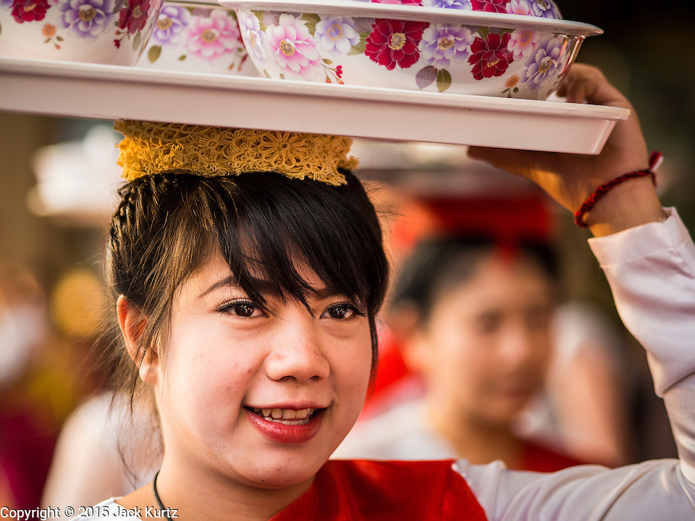 """14 JANUARY 2015 - BANGKOK, THAILAND:  Women walk in the 2015 Discover Thainess parade. The Tourism Authority of Thailand (TAT) sponsored the opening ceremony of the """"2015 Discover Thainess"""" Campaign with a 3.5-kilometre parade through central Bangkok. The parade featured cultural shows from several parts of Thailand. Part of the """"2015 Discover Thainess"""" campaign is a showcase of Thailand's culture and natural heritage and is divided into five categories that match the major regions of Thailand – Central Region, North, Northeast, East and South.    PHOTO BY JACK KURTZ"""