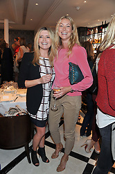 Left to right, TINA HOBLEY and HEIDI BISHOP at a lunch to launch Cash & Rocket on Tour 2013 hosted by Julia Brangstrup in aid of Orpan Aid and Shine on Sierrra Leone held at Banca, 40 North Audley Street, London on 29th April 2013.