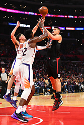 February 14, 2019 - Los Angeles, CA, U.S. - LOS ANGELES, CA - FEBRUARY 13: Los Angeles Clippers Center Ivica Zubac (40) shoots over Phoenix Suns Center DeAndre Ayton (22) during a NBA game between the Phoenix Suns and the Los Angeles Clippers on February 13, 2019 at STAPLES Center in Los Angeles, CA. (Photo by Brian Rothmuller/Icon Sportswire) (Credit Image: © Brian Rothmuller/Icon SMI via ZUMA Press)