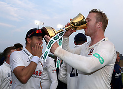 Essex's Simon Harmer holding the Division 1 Championship Trophy after day three of the Specsavers County Championship, Division One match at the Cloudfm County Ground, Chelmsford.