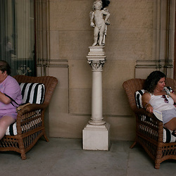 ASHEVILLE, NC-- Pam Bass, right, of Phoenix, AZ relaxes on the porch of the Biltmore Estate.