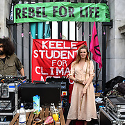 Jade Wade band The Odd 910 preforms at XR Invites London - Earth Feast, hundreds of Extinction Rebellion continue camping and protest for a climate change demand the UK govt to take action not for profit on 22 April 2019, London, UK.