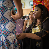 Lydie Malingumu checking a dress, she takes care personaly of her clients, many of them are part of the elite of the Congolese capital. CAPTA/FEDERICO SCOPPA