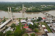 Coca Town showing Napo River & New Bridge crossing into Yasuni Biosphere Reserve<br /> Puerto Francisco de Orellana or Coca, Amazon Rainforest<br /> ECUADOR. South America