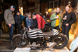 Checking out a BMW on display Friday night at the One Show motorcycle show in Portland, OR. February 12, 2016. ©2016 Michael Lichter