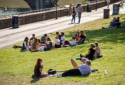 "© Licensed to London News Pictures; 21/09/2020; Bristol, UK. A group of 15 young people sit in Castle Park. Groups of people, some more than six in number, enjoy the sunshine and hot weather on the last official day of summer in Bristol city centre, amid concerns about a second wave of the covid-19 coronavirus pandemic across the UK, with many areas going into local lock down. From Monday 14 September it was illegal to meet up socially in groups of more than six people, known as the ""Rule of Six"", in order to try and contain the spread of the covid-19 coronavirus pandemic, and police have said they will enforce the law with fixed penalty notices which will increase for repeat offenders. Photo credit: Simon Chapman/LNP."