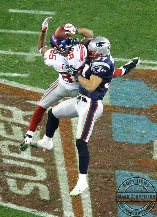 Giants David Tyree pulls in long pass over Patriots James Butler in the fourth quarter of Super Bowl XLII at University of Phoenix Stadium in Glendale, Arizona, on Sunday, February 3, 2008. (Mark Cornelison/MCT)