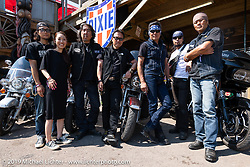 Japanese visitors (L>R) Seven Motorcycles Takatoshi Suzuki, Nanae Suzuki, Shinichi Haraki, Masayuki Ikeda, Ken Nagai of Ken's Factory, Kazuo Matsumoto and Taka Masui at the the Iron Horse Saloon during the Sturgis Black Hills Motorcycle Rally. Sturgis, SD, USA. Tuesday, August 6, 2019. Photography ©2019 Michael Lichter.