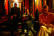 """Ricardo Pereira performing at """"Faia"""". """"Faia  is one of most famous restaurants were to see live perfomances of Fado music. It was founded in 1947 by Lucilia do Carmo, one of the legendary woman Fado singers."""