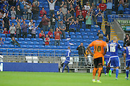Kenwyne Jones of Cardiff city © celebrates in front of Cardiff fans after he scores his teams 1st goal. Skybet football league championship match, Cardiff city v Wolverhampton Wanderers at the Cardiff city stadium in Cardiff, South Wales on Saturday 22nd August 2015.<br /> pic by Andrew Orchard, Andrew Orchard sports photography.