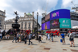 © Licensed to London News Pictures. 29/05/2021. London, UK. Visitors to Piccadilly Circus enjoy her warm weather during the Bank Holiday Weekend. Photo credit: London News Pictures