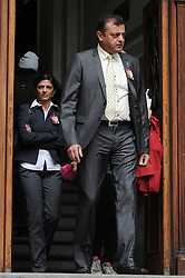 © Licensed to London News Pictures. 08/10/14. CAPE TOWN, SOUTH AFRICA -   Ashok Hindocha (front) and Ami Denborg (back) leaves court during Day 3 of the Shrien Dewani trial at the Cape High Court before Judge Jeanette Traverso. Dewani is caused of hiring hit men to murder his wife, Anni. Anni Ninna Dewani (née Hindocha; 12 March 1982 – 13 November 2010) was a Swedish woman who, while on her honeymoon in South Africa, was kidnapped and then murdered in Gugulethu township near Cape Town on 13 November 2010 . Photo credit : Roger Sedres/LNP